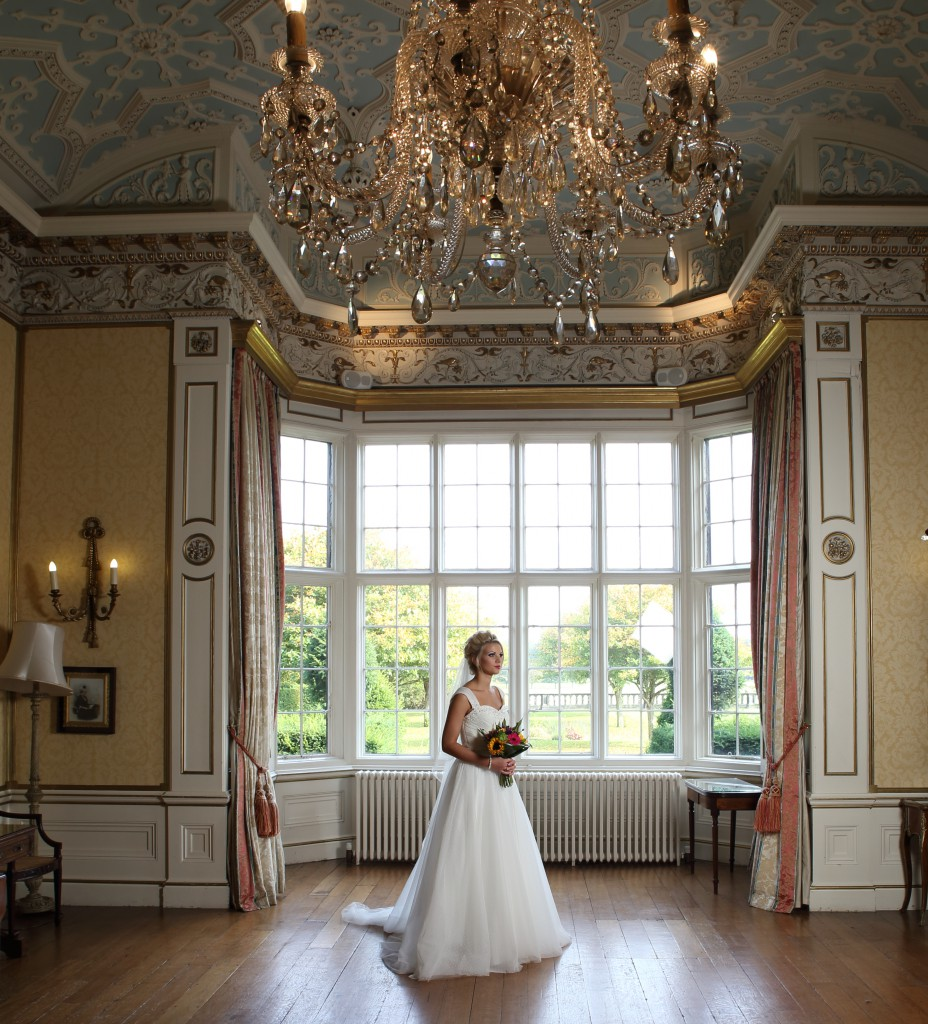 wedding photography prices: bride in stately house