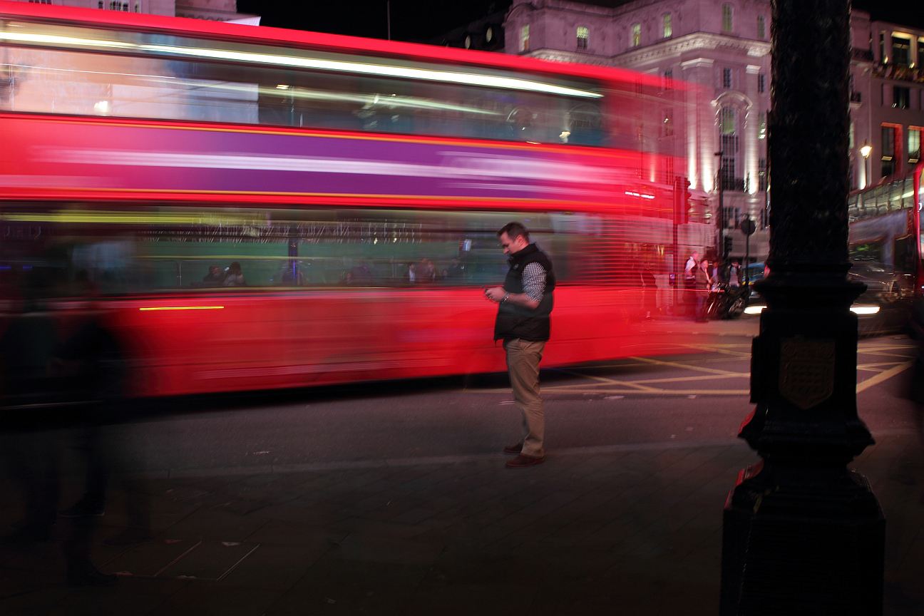 street scene at night in picadilly
